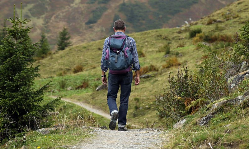 hiking clothing tips - dude hiking in jeans
